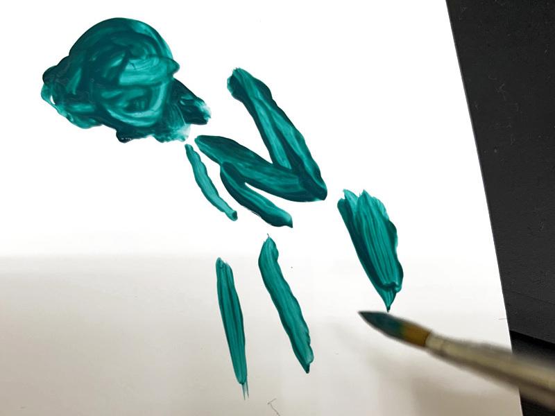 5:パレットで筆を使って塗料をこねる